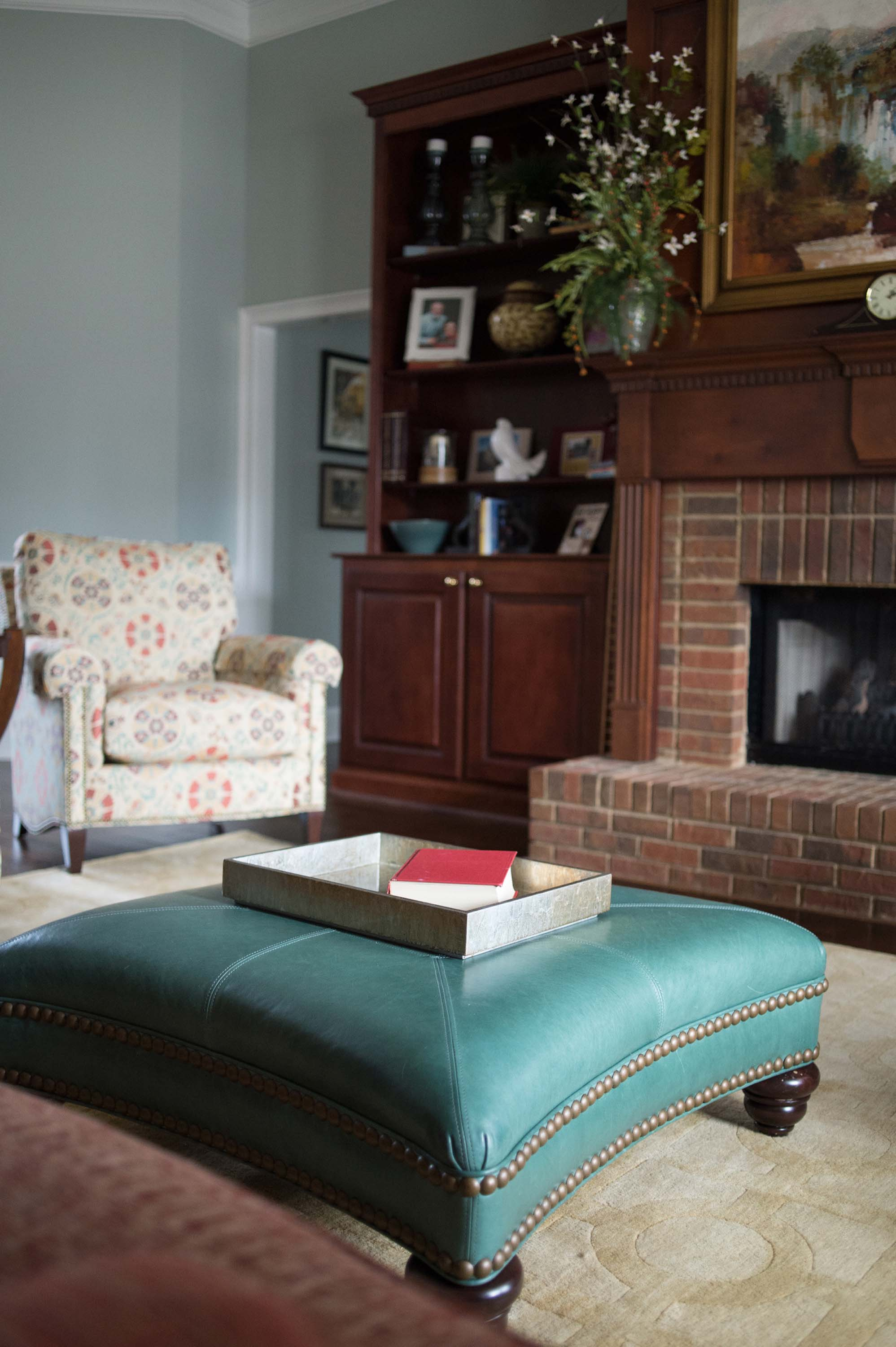 Printed Chair with Built In Bookshelves and Custom Leather Ottoman