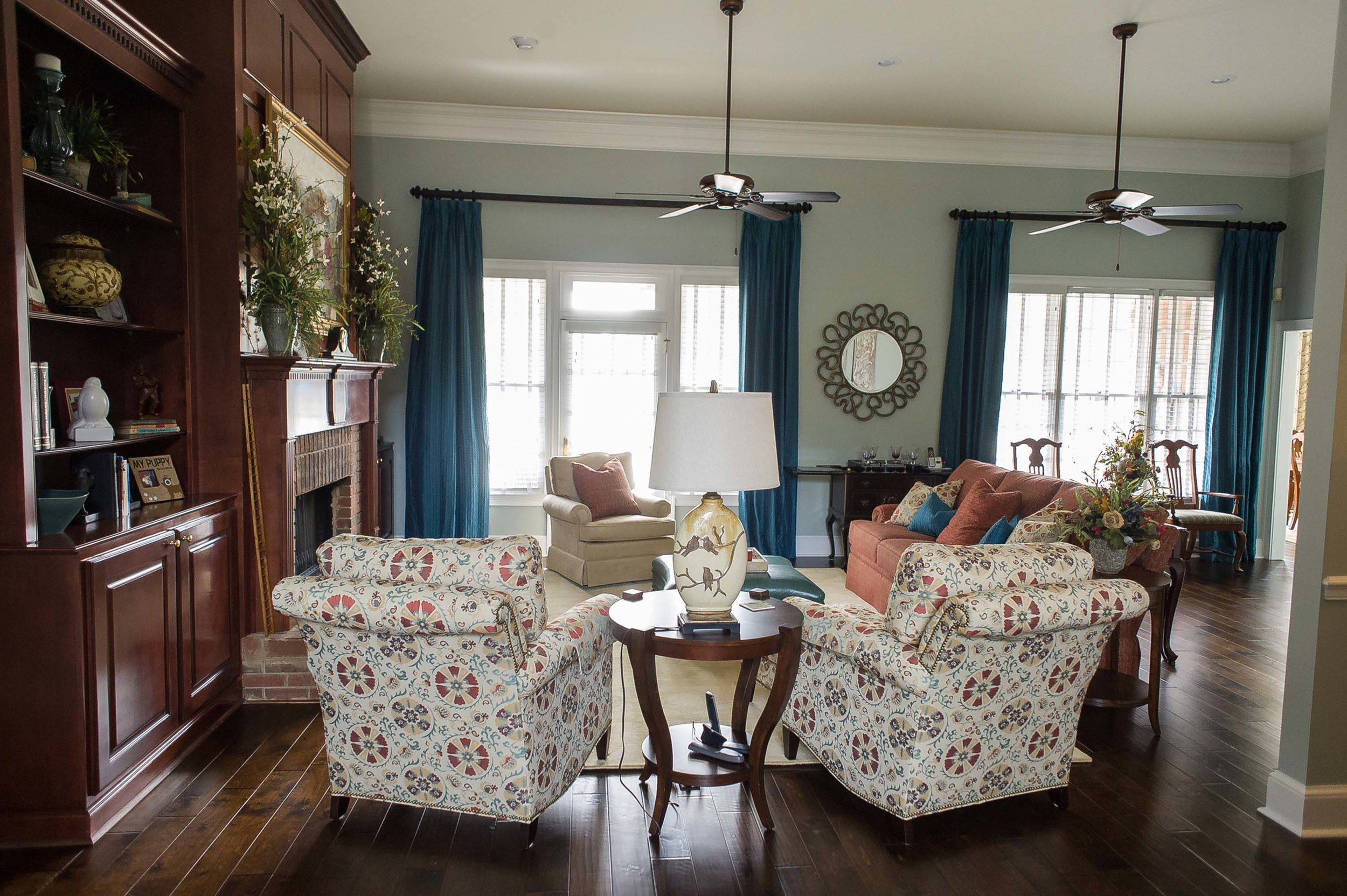 Matching Printed Chairs with Custom Blue Panels and Lamp