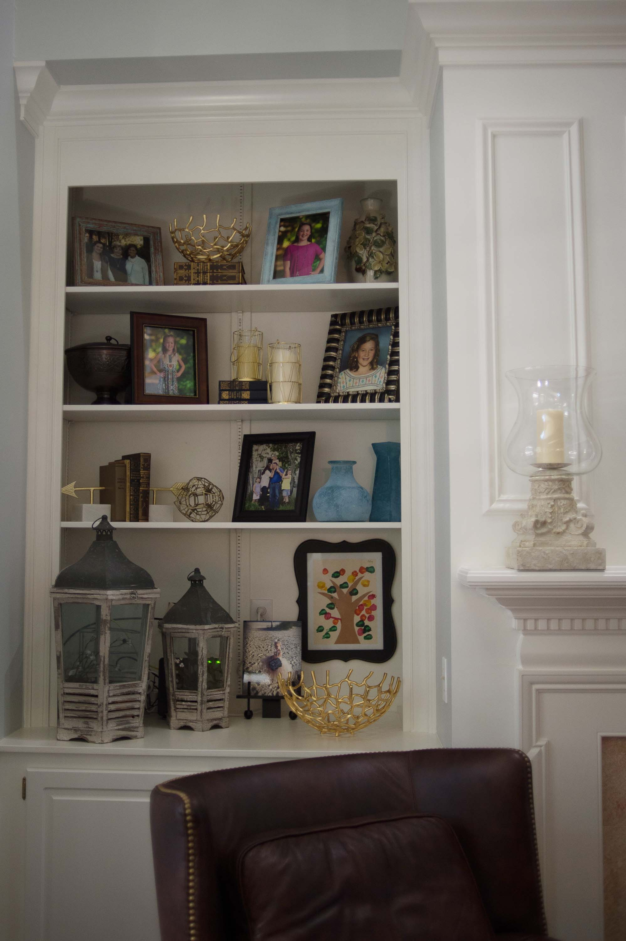 Custom Built In Bookshelves with Picture Frames, Lanterns and Accessories