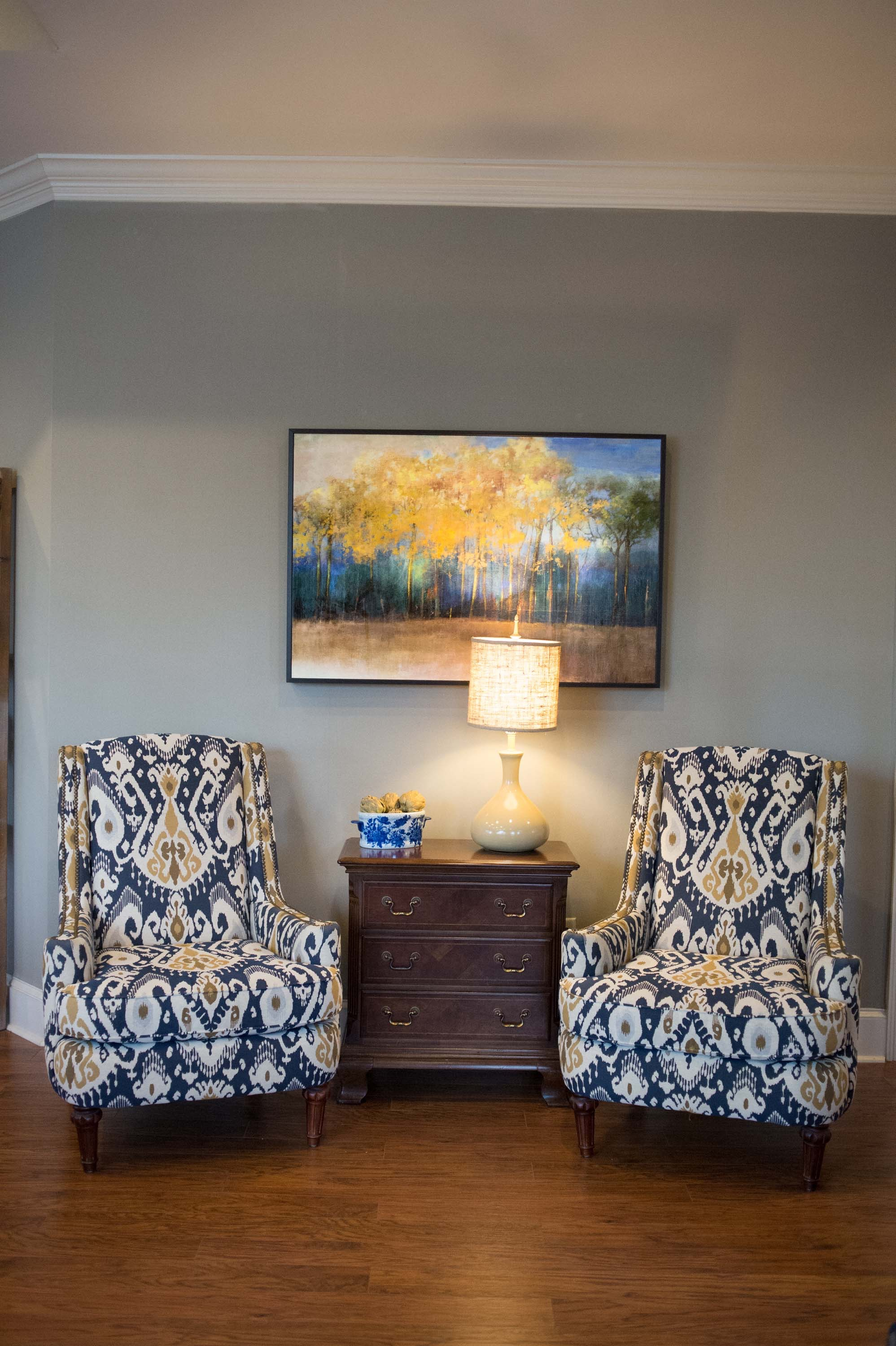 Upholstered armchair with artwork