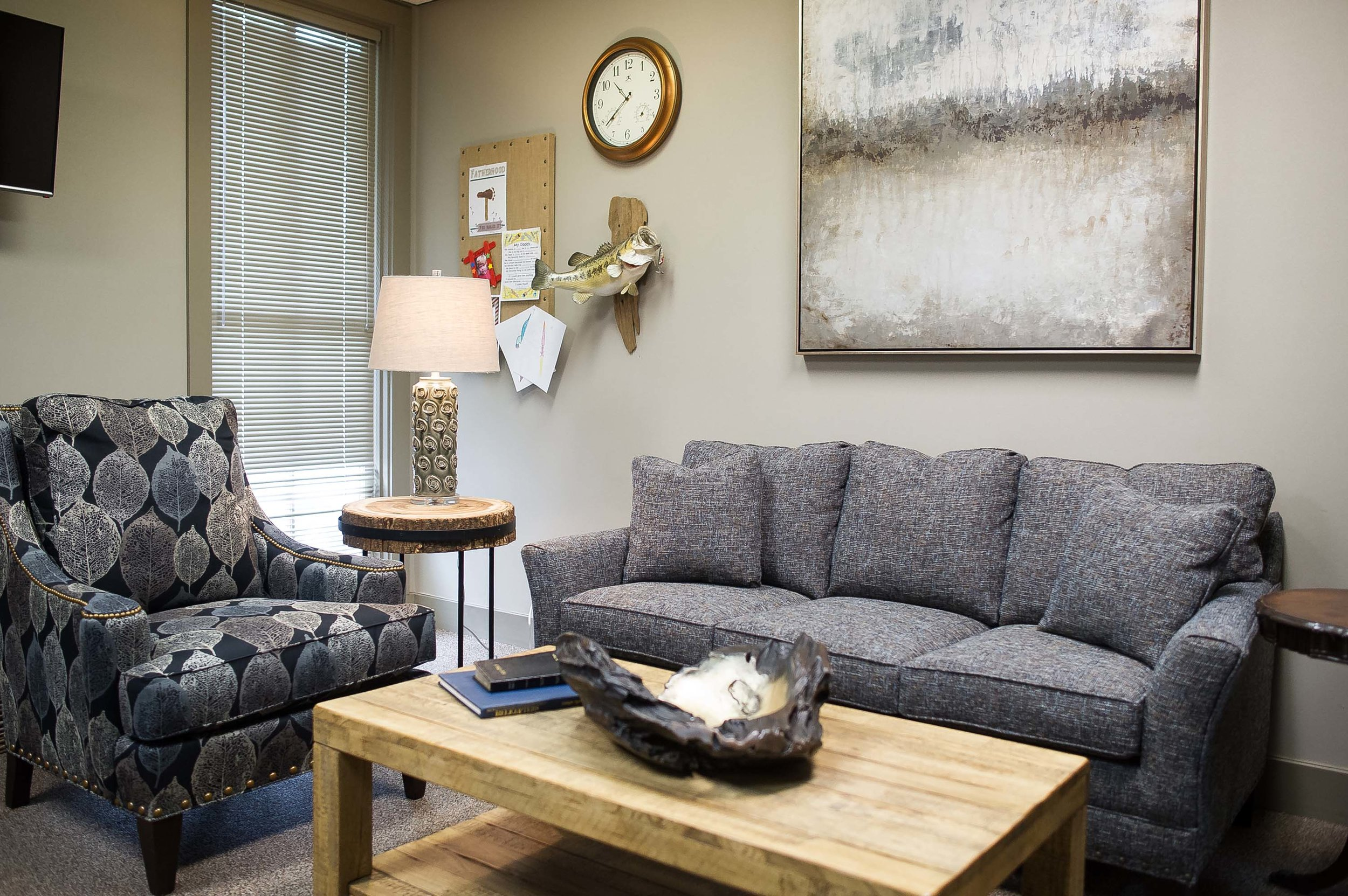 professional office with custom upholstered sofa