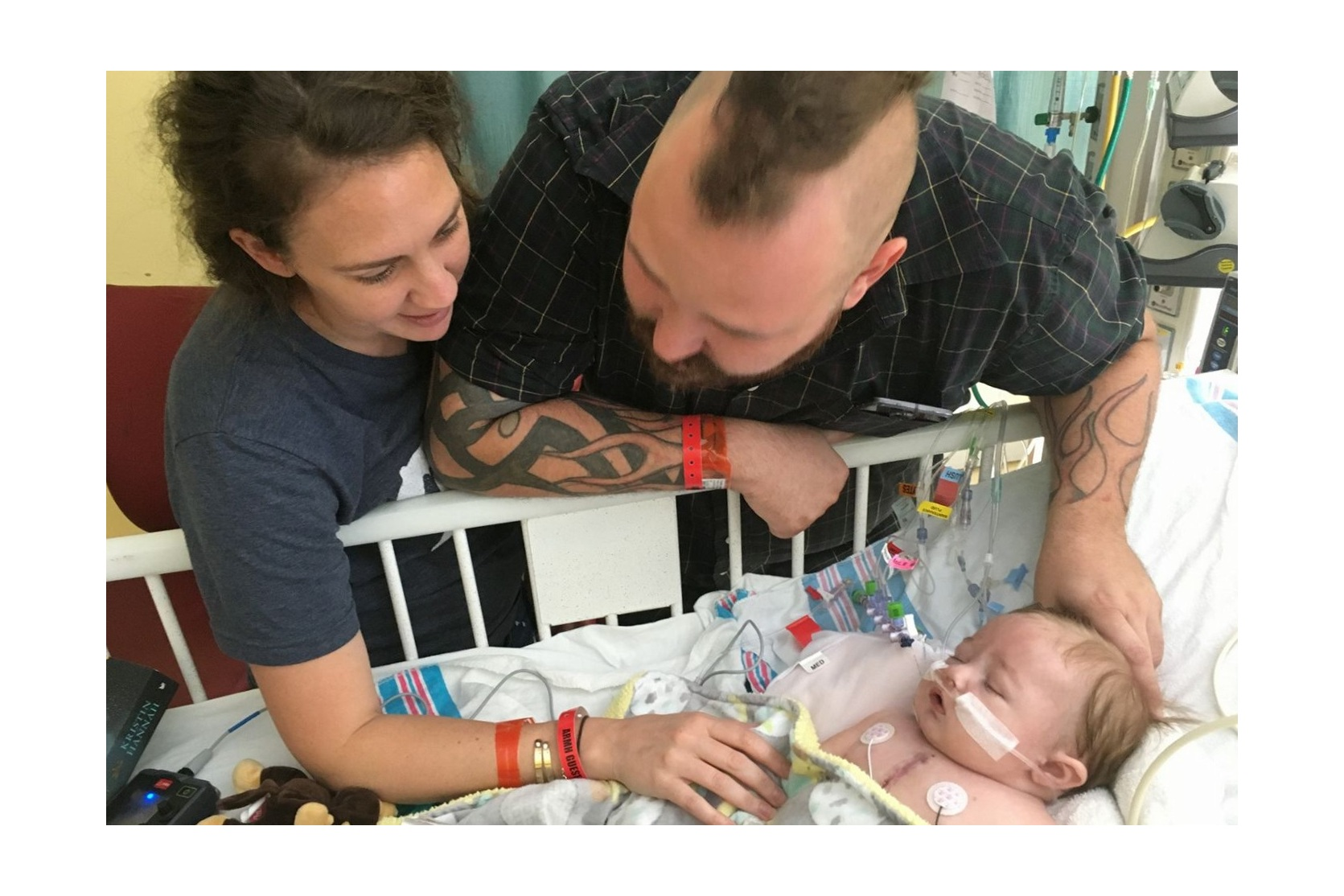 Lachlan with his mom and dad after open heart surgery