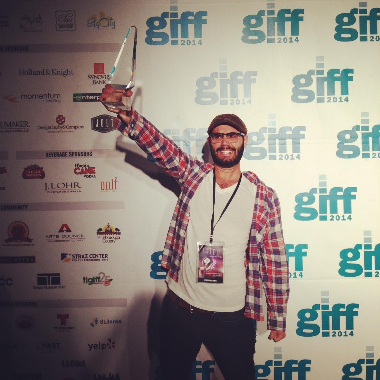 """Torre Catalano Hoisting the Best Picture Award for his film """"Seasick Sailor"""""""