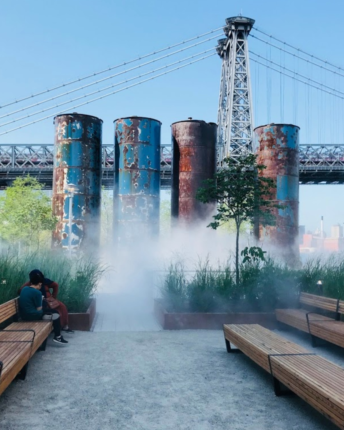 """""""The history of the land itself fascinates me…"""" - """"The Domino Sugar Refinery once produced more sugar than anywhere else in the world. Here at Domino Park, cranes, tanks, and columns that were original to the Refinery are still on site and have been painted or refurbished to match the park's signature aesthetic.""""-Basmajian"""