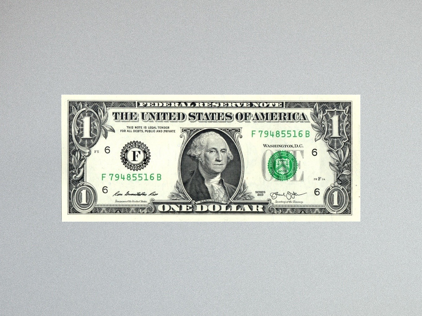 One $1 dollar bill on minimalist gray background.