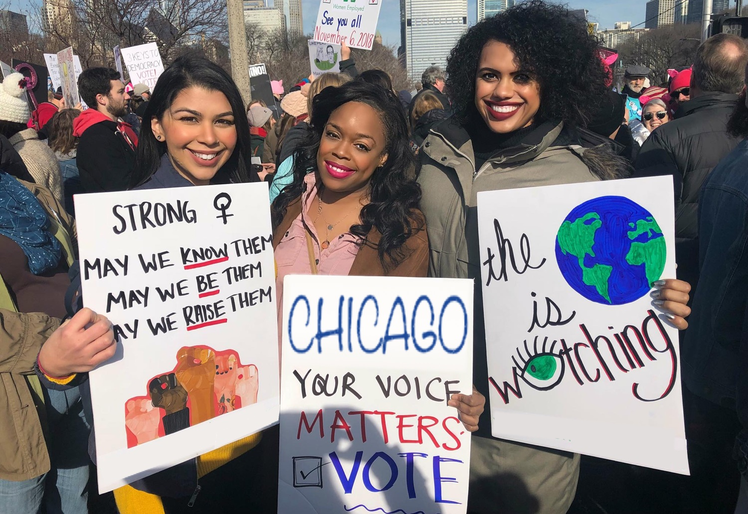 "Kina at the Chicago Women's March with a sign that reads ""Chicago Your Voice Matters - Vote."""