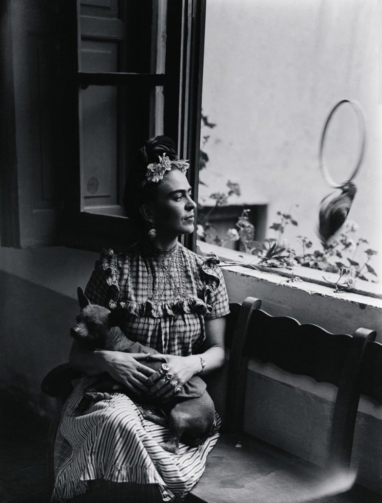 Legendary Mexican artist Frida Kahlo is pictured here holding her dog in the Mexico City home she lived in with her husband, fellow artist Diego Rivera.