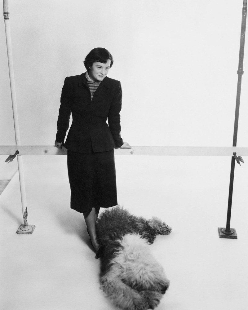 Studying under Mies van der Rohe and Eliel Saarinen, American-born Florence Knoll is best known for her unique vision as an architect and furniture designer. Here, Knoll, who cofounded the multibillion-dollar design firm that bears her name, is posing for a photo with her dog.