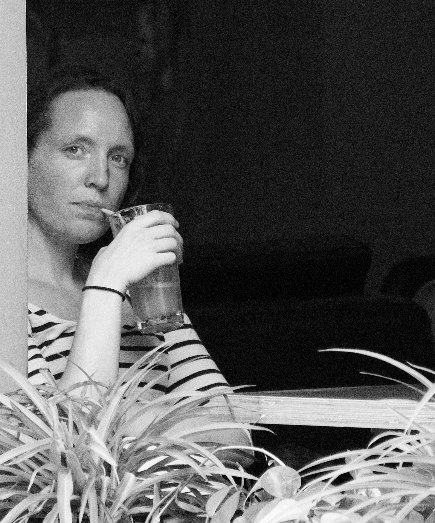 8669-woman-staring-out-restaurant-window-Beijing.jpg