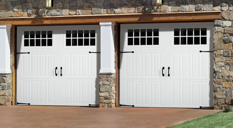 CARRIAGE HOUSE SERIES  Openings in Carriage House Style. Looks can be deceiving. From a distance, you see an authentic carriage house door. Up close, they go up and down like traditional garage doors. Available in Steel and Wood.