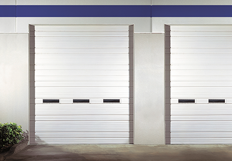 SECTIONAL STEEL DOORS  Industrial Series doors feature a variety of standard ribbed, flush and embossed patterns such as stucco and woodgrain. Available in a wide selection of gauges for pro-grade durability, this series is a great choice for high-traffic applications including warehouses, distribution centers and loading docks.