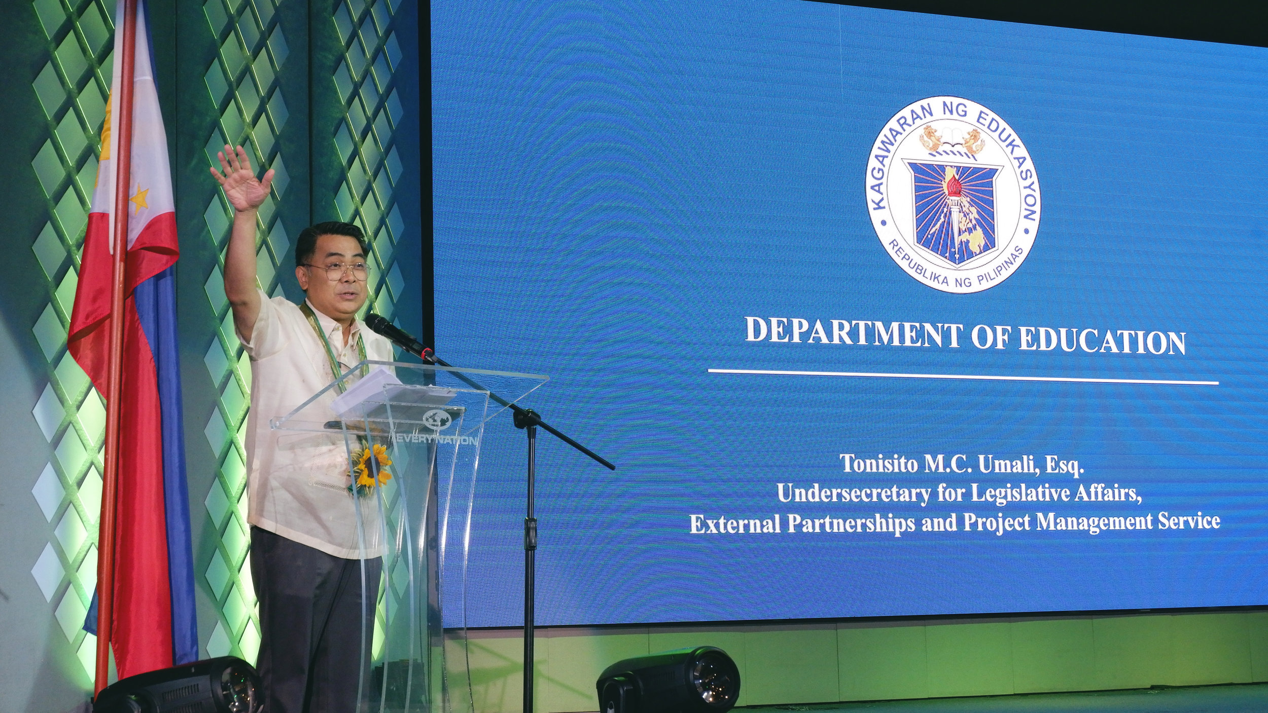 Usec. Tonisito Umali explaining the mandate of the Philippine Constitution to make quality education accessible to all Filipino students. He shared how DepEd has been building external partnerships through the years to make this possible. He also announced DepEd's partnership with Real LIFE and encouraged the schools to partner with the foundation as well.
