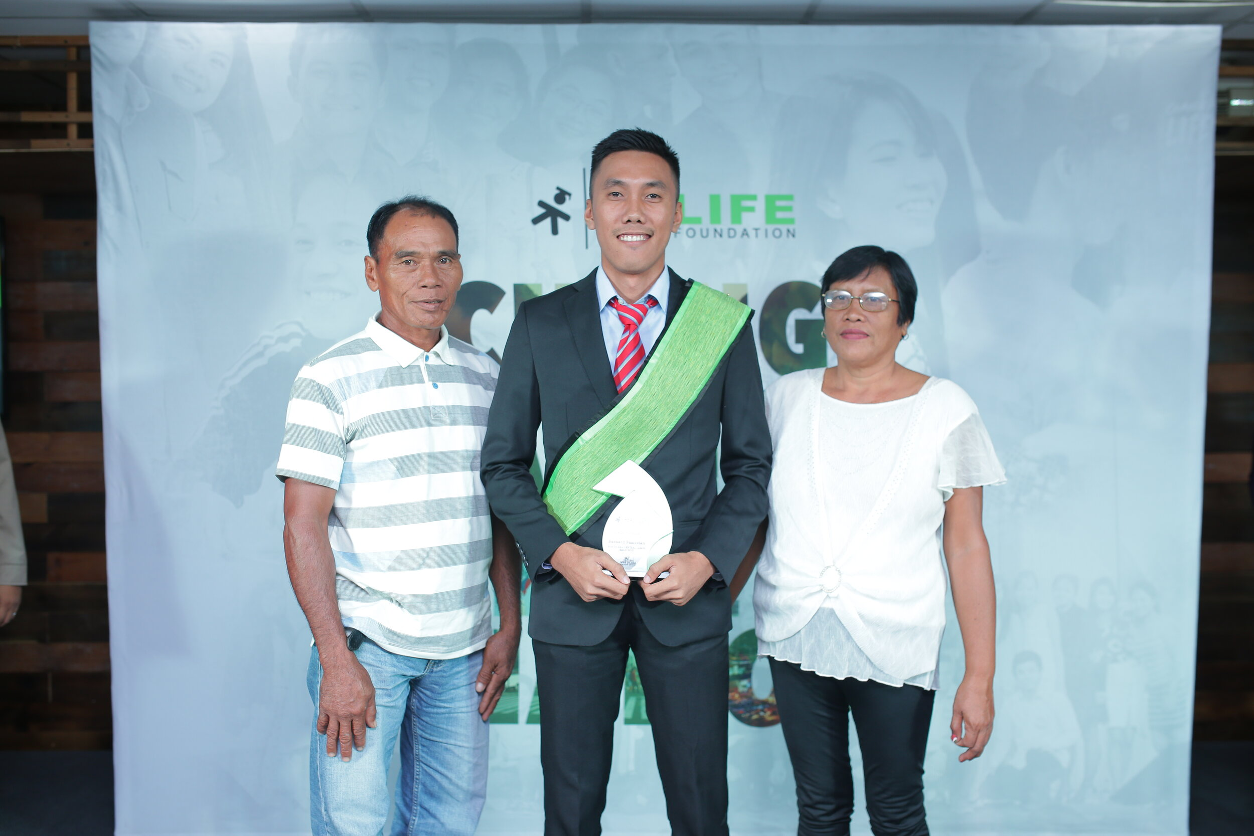 Bernard with his parents receiving the integrity awardee at our North and Central Luzon Graduation Banquet last August 31, 2019
