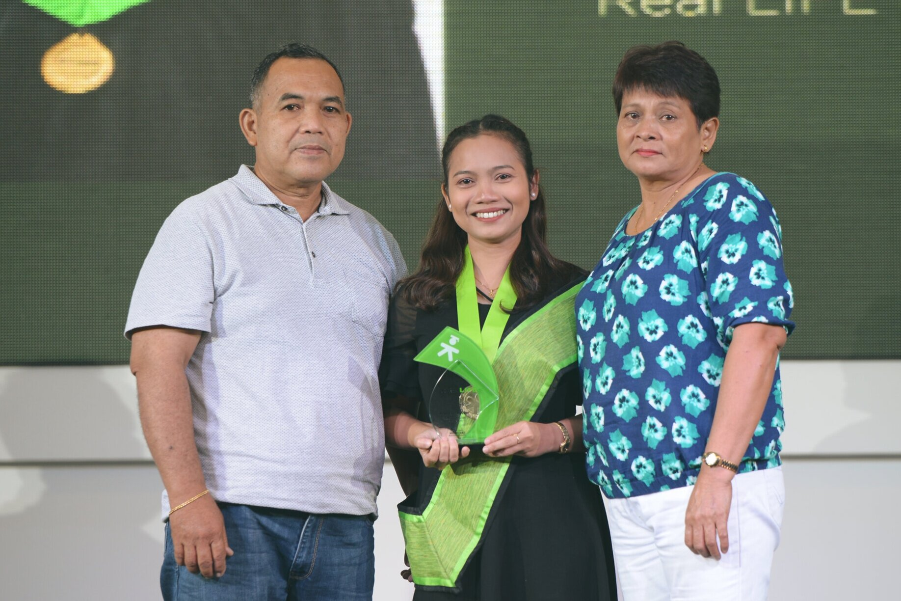 Jonalyn with her parents receiving the faith award at our South Luzon Graduation last August 17, 2019.  Her father is now strong and well and is on his way to full recovery.