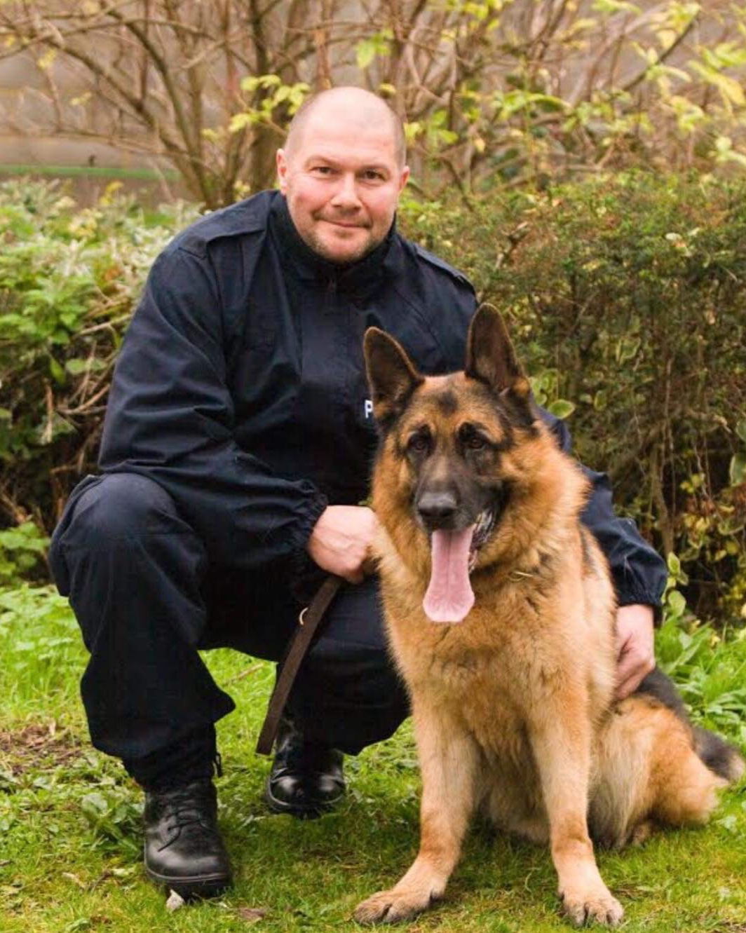 """Paul Wood - Trustee - PC Paul Wood has served in the British Transport Police dog section for 22 years. During that time he has worked 3 German Shepherds & a Border Collie, Charlie, who was retired at 9 years.He has been involved in the Battersea Dogs Home display at Crufts & appeared in TV series, """"Send in the Dogs"""".Paul has received 2 commendations and a medal for long service. He now works alongside PD Albert & is proud to be a trustee of Railway Dogs Benevolent Fund."""