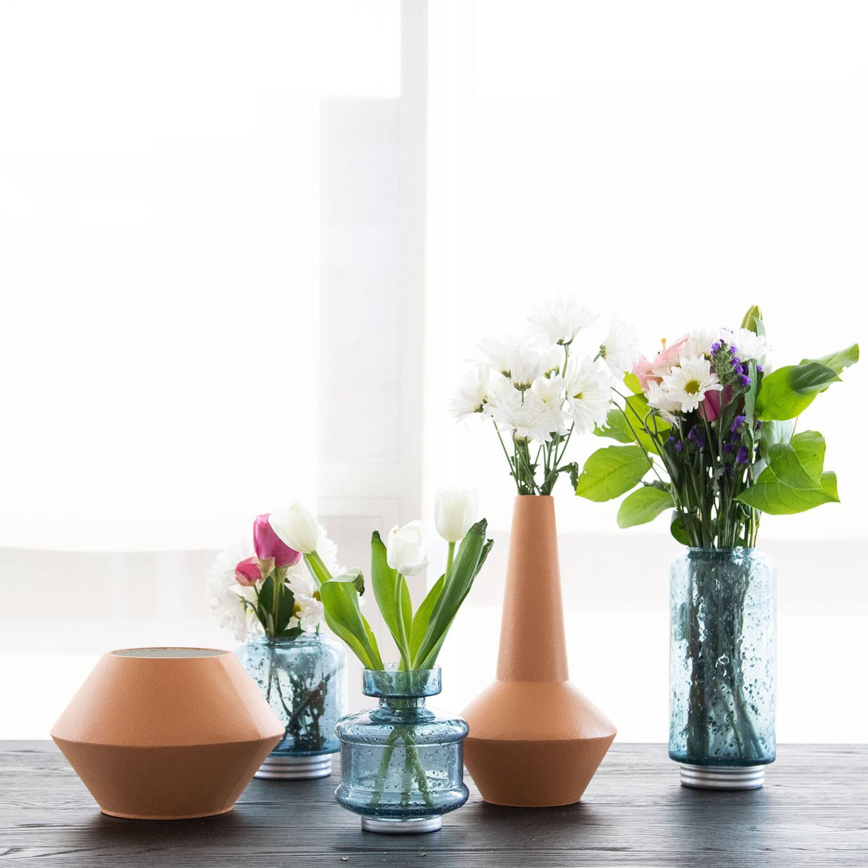 Items Shown:  Metal Terracotta Vase Wide ,  Metal Terracotta Vase Tall ,  Marina Vase Large ,  Marina Vase Narrow ,  Marina Vase Small
