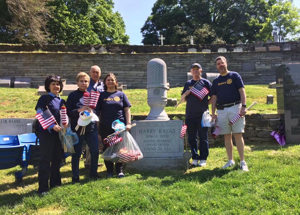 Placing U.S. flags on veterans' gravesites