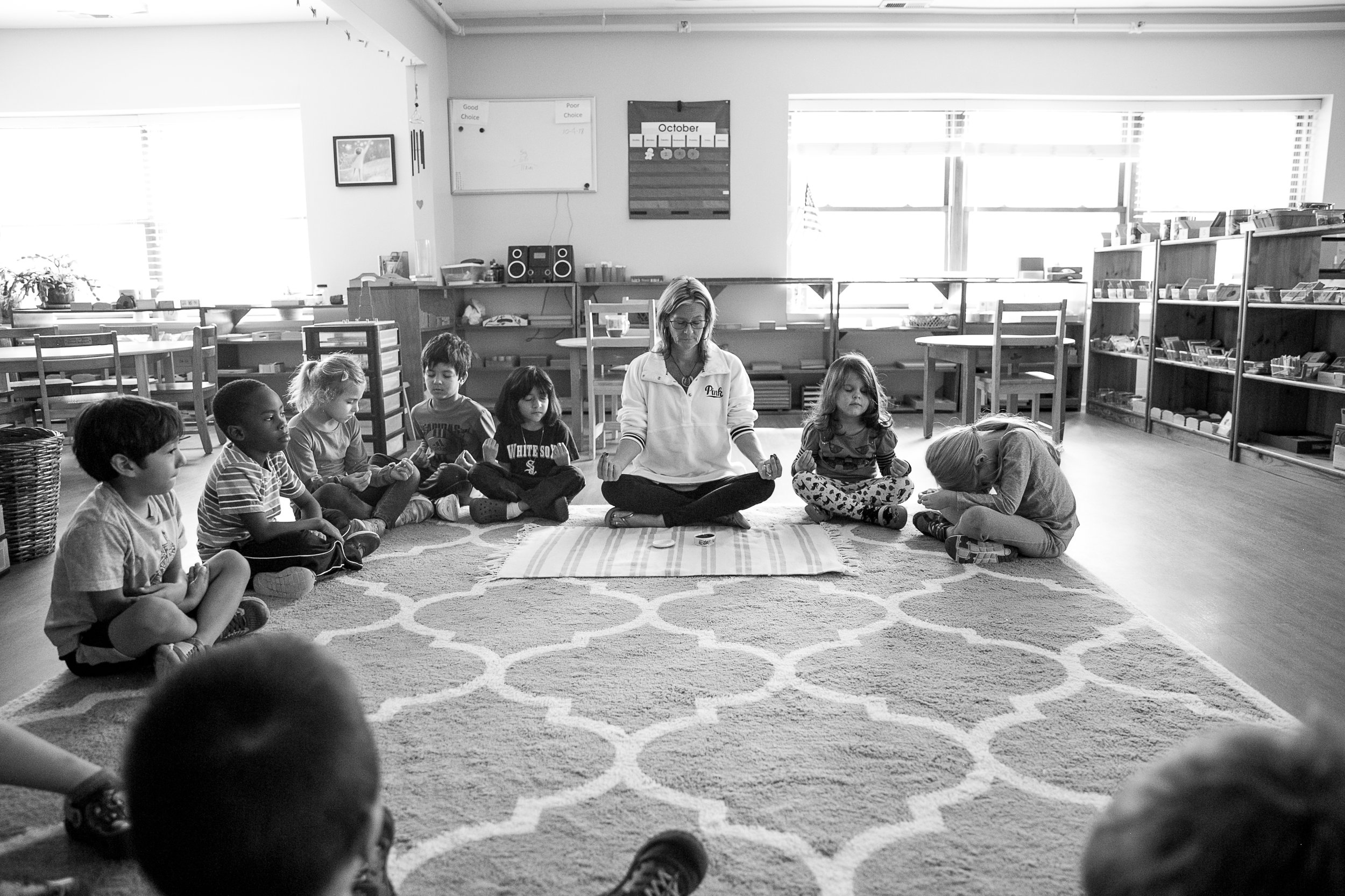 "Promoting Peace - During guided meditation, children are encouraged to ""get all the wiggles out"" and then ""be as still as still can be"" as a welcome transition from active work time to lunch and recess."