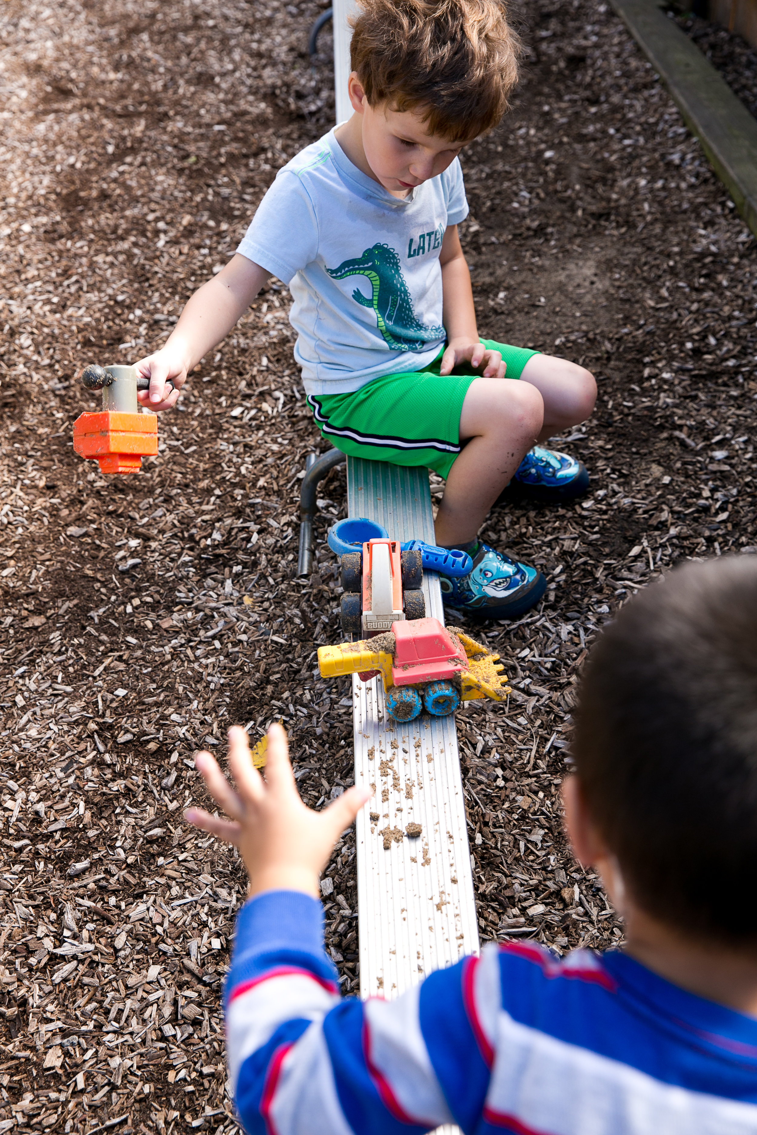 Outdoors / Gross Motor - Outside time develops gross motor skills, social interaction and awareness of the natural world. In the event of inclement weather, children continue to develop their gross motor skills through a variety of indoor physical activities.