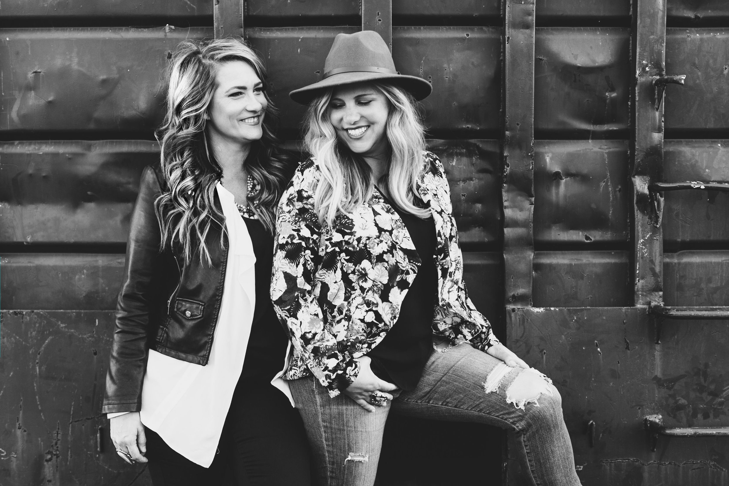 We're kristina + jo - Photographers for the daring and fashionable.