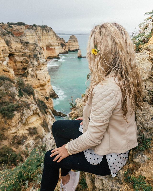 Ponta da Piedade ✨ where exposed cliffs reveal their golden color and surround themselves with turquoise sea waters that can only be described as stunning⠀ ⠀ These cliffs are the finest natural features of the Algarve. The dramatic limestone coastline is formed of sea pillars, fragile rock arches and hidden grottos, all of which have been chiseled-out by savage winter storms.⠀ ⠀ There are four different cliff walks, this one in particular was mostly untracked, and an unexpected steep climb. Walking through wild flowers to this world view of the Algarve proved to be well worth it. ⠀ ⠀ Anyone afraid of heights? The more I travel the more I discover that I'm not afraid and find each climb and high point all the more liberating. ⠀ ⠀ There is something about seeing a landscape from a different viewpoint that really makes you inhale all its beauty around you, and another reason why Portugal truly is a magical place, you never know what you may find. ⠀ ⠀ Love always, @thenomadinfluence⠀ ⠀ ⠀ ⠀ #livetodayposttomorrow #thenomadinfluence #traveldames #gltlove #girlsthatwander #shetravels #wearetravelgirls #digitalnomadgirl #nomadgirls #girlaroundtheworld #visitportugal #discoverportugal #lagosportugal #dametraveler #sheisnotlost