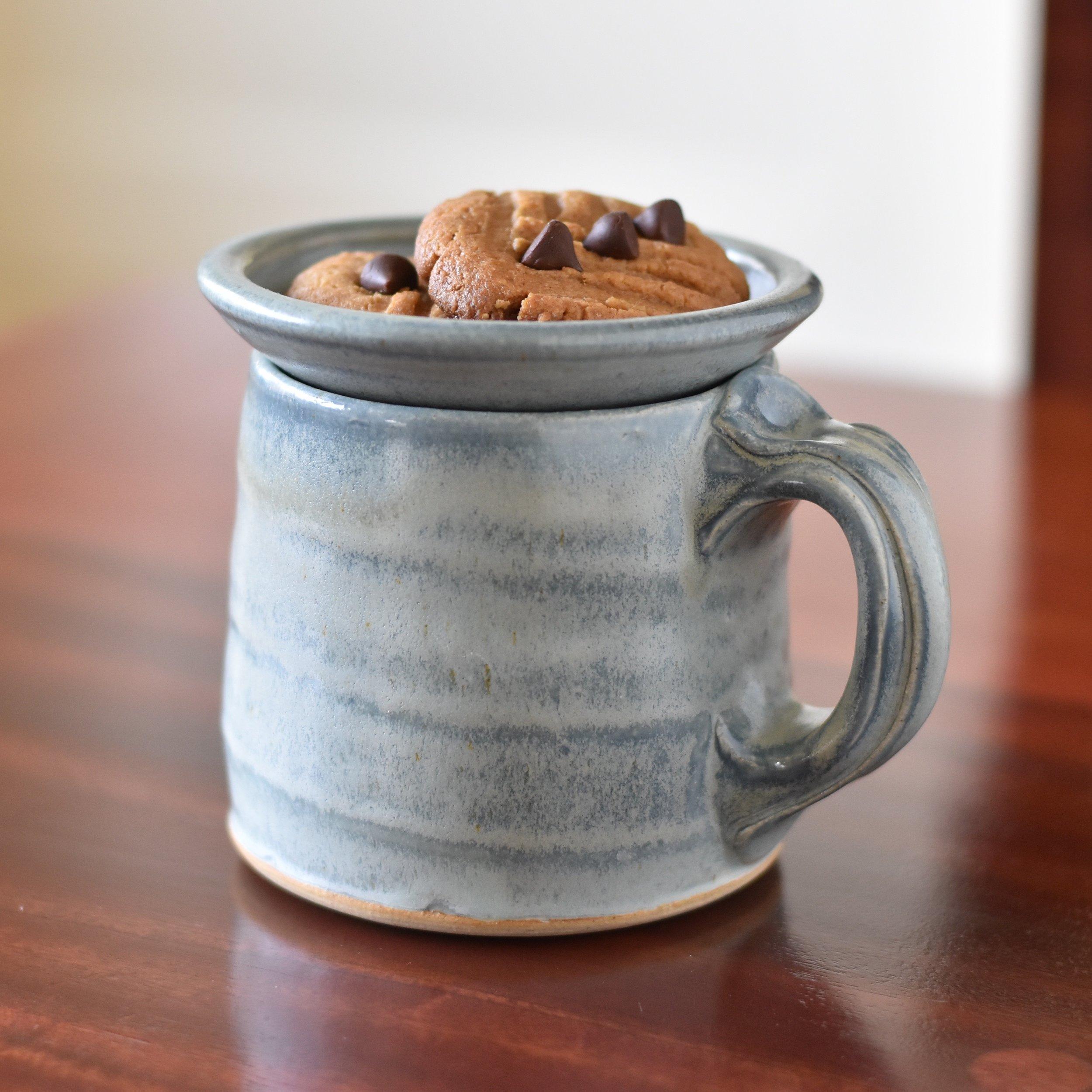 Handmade mug with topper Lucy Fagella.