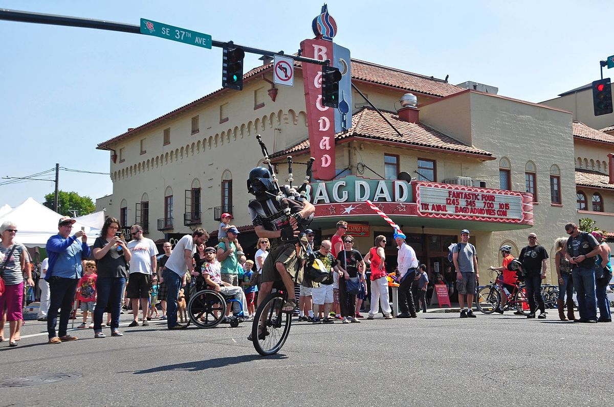 The_Unipiper_entertaining_a_crowd_gathered_in_front_of_the_Bagdad_Theater_in_Portland,_Oregon.jpg