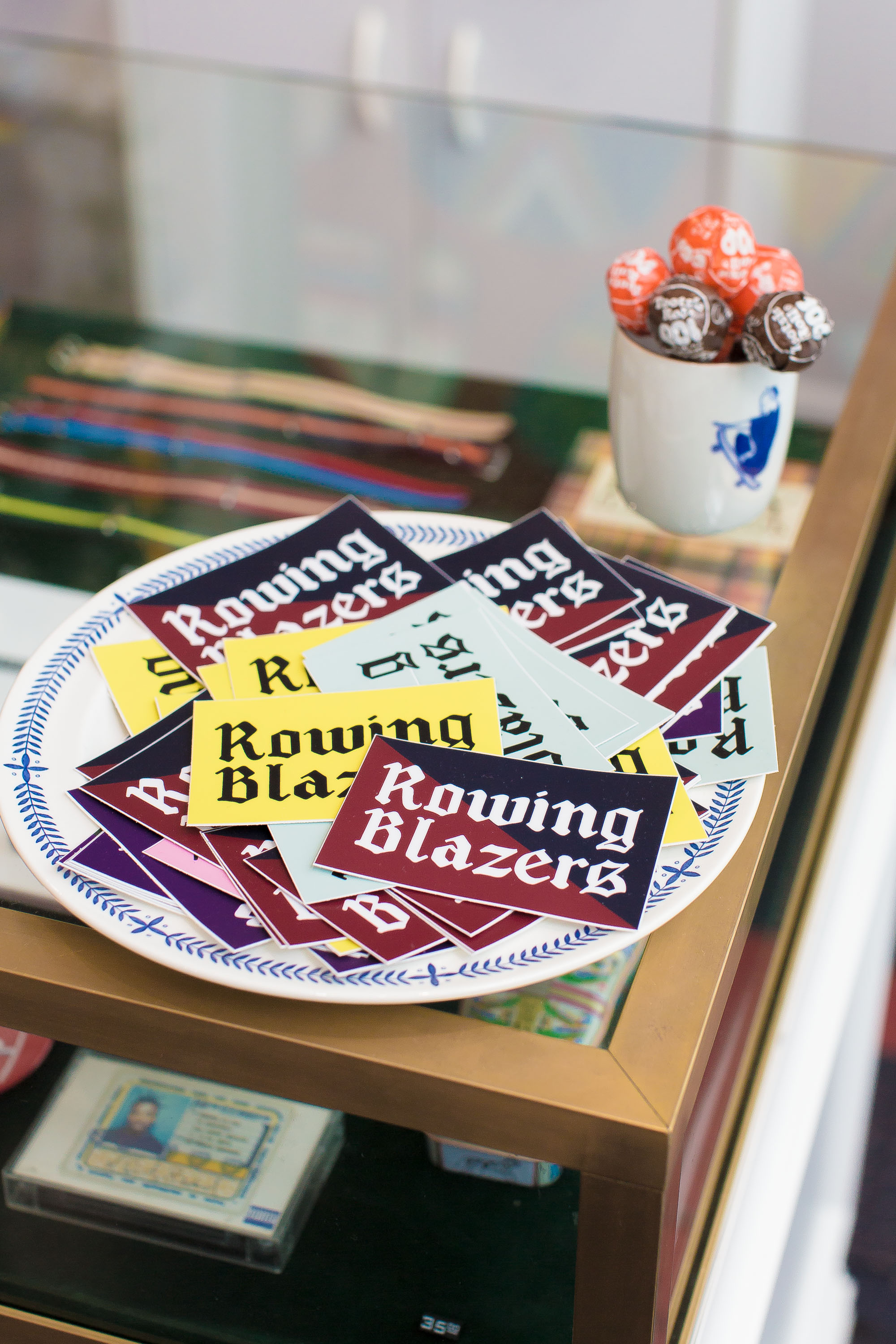 Rowing Blazers stickers sit atop a counter top just over the Ol' Dirty Bastard cassette tape.