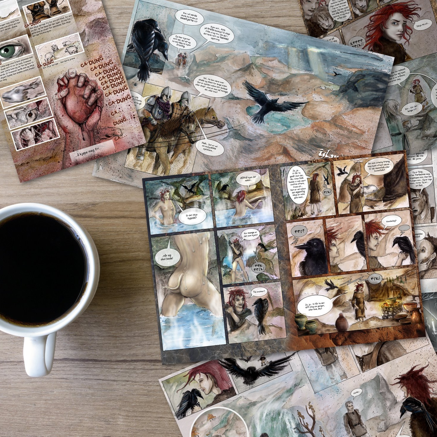 Desk with coffee and graphic novel pagespreads