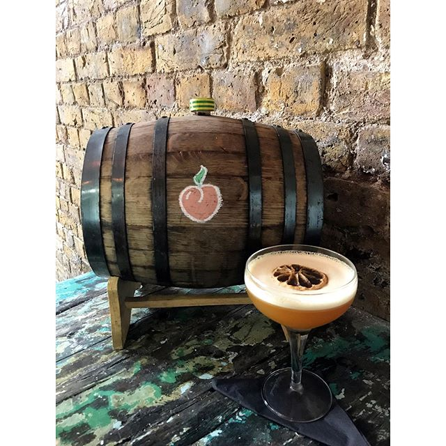 Feeling peachy? Our 'peaches in the barrel' cocktail combines cask aged rum, peach liqueur and a dash of chocolate bitters 🍑