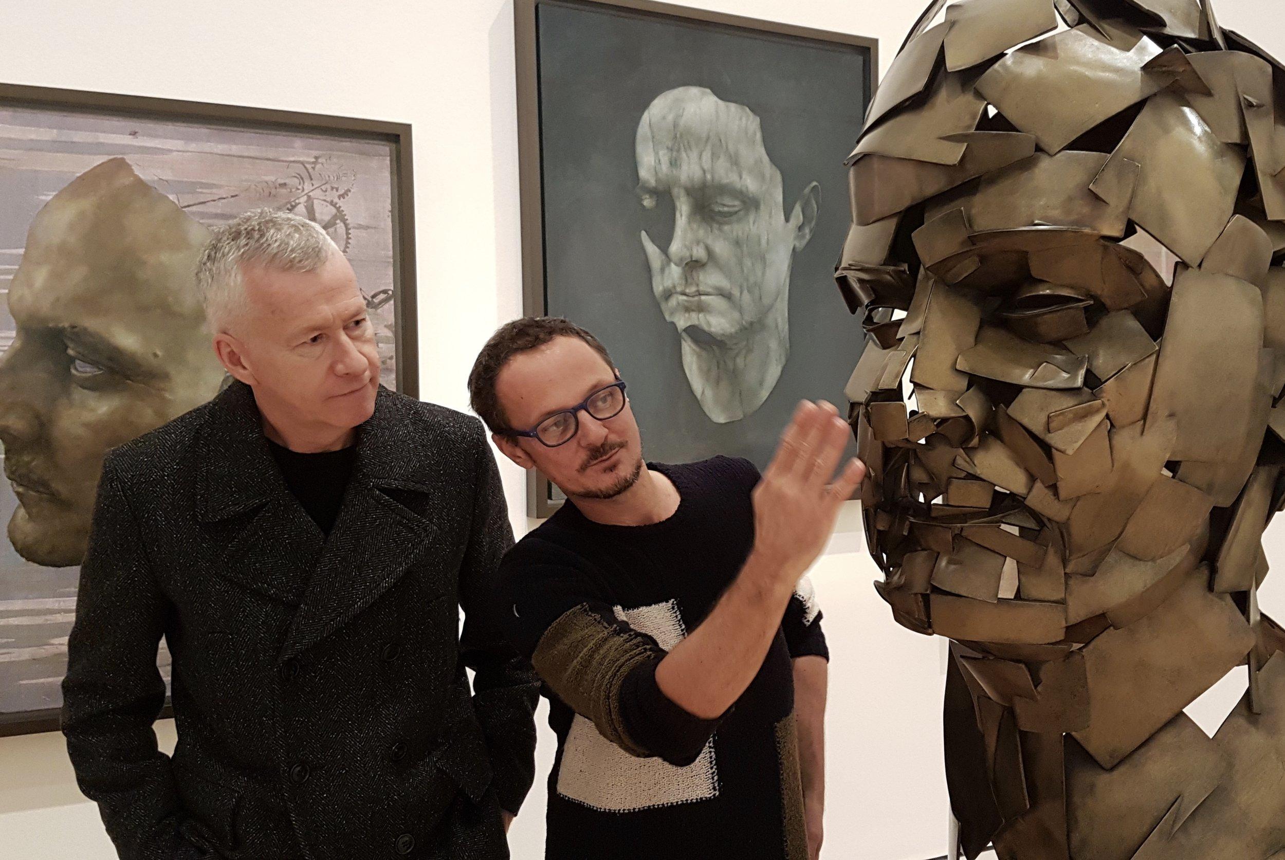 Jonathan Yeo shows John a bronze self portrait he made using a virtual paintbrush and digital 3D scanning technology. Photo Jerome Weatherald