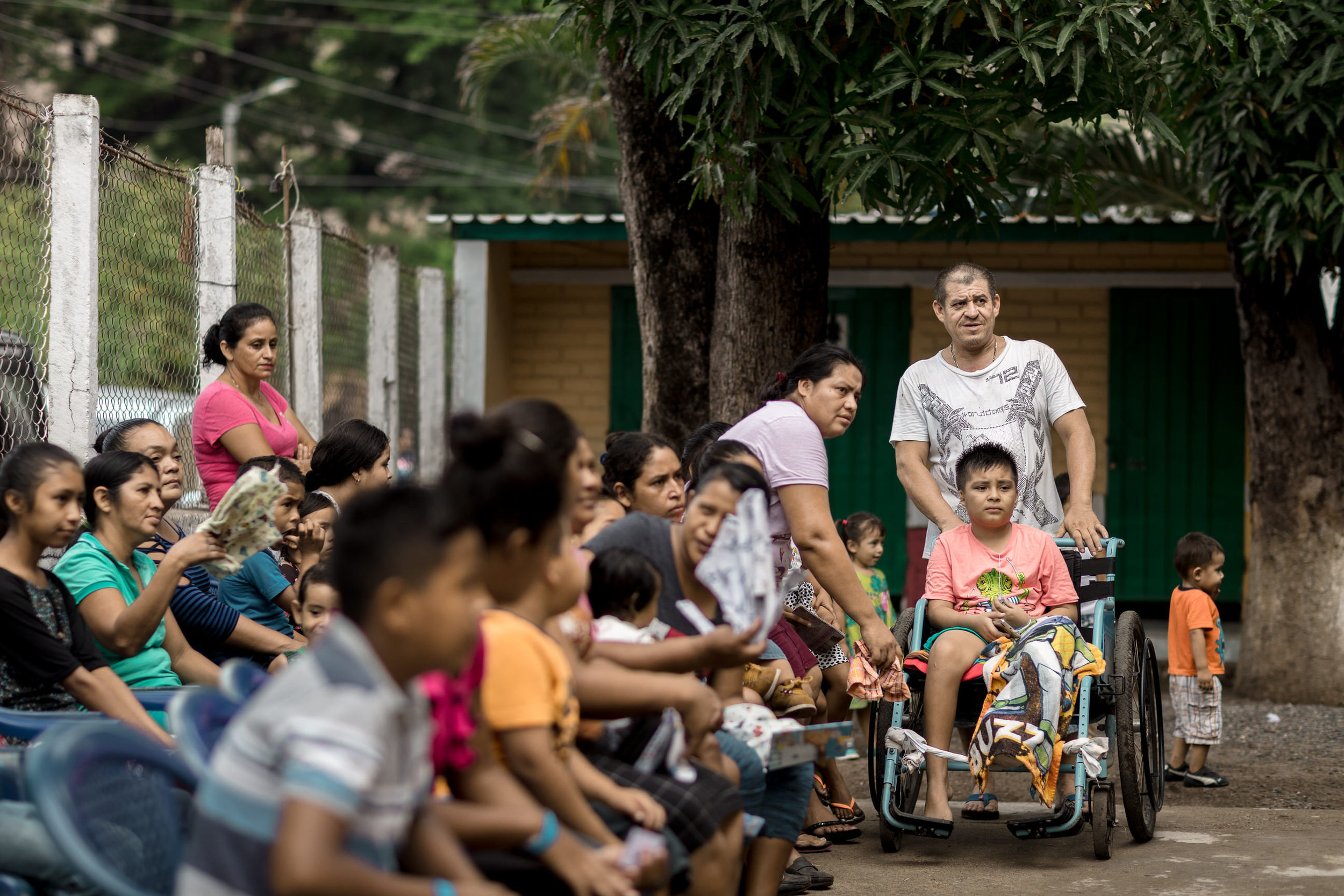 Patients waiting to be seen at a mobile clinic in El Salvador