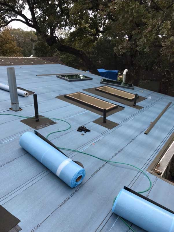 Installation-Of-Self-Adhering-Modified-Bitumen-Roofing.jpg