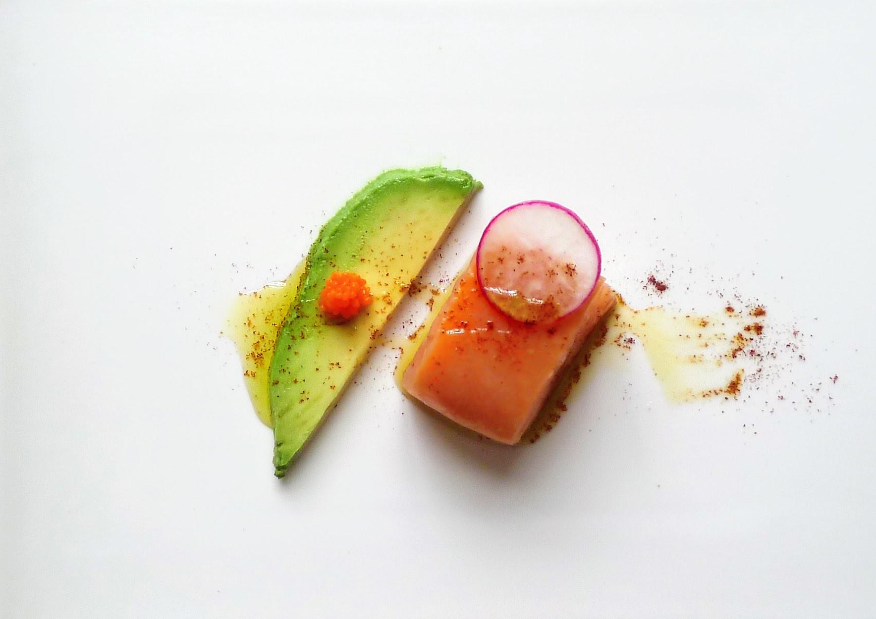 Sous vide Gravlax (Salmon) with avocado, Carrot caviar, radish, EVOO & Paprika