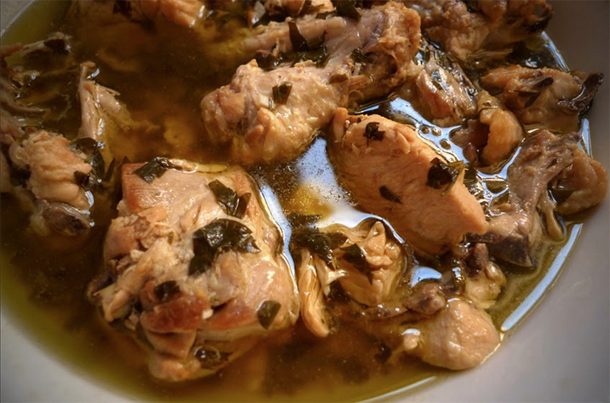 Traditional Pollo al Ajillo cooked with Garlic dressing, Parsley and Vinegar