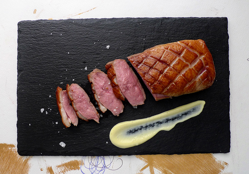 Sous Vide Duck Breast with crispy skin served with poached Egg cream