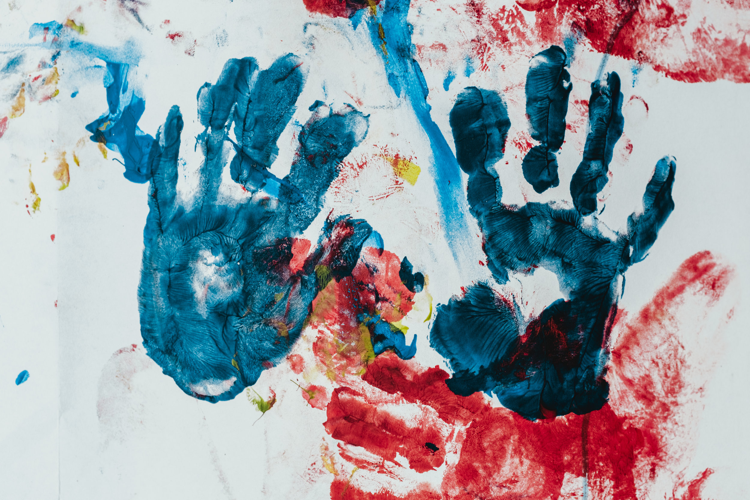 Image of two blue hands from finger painting.