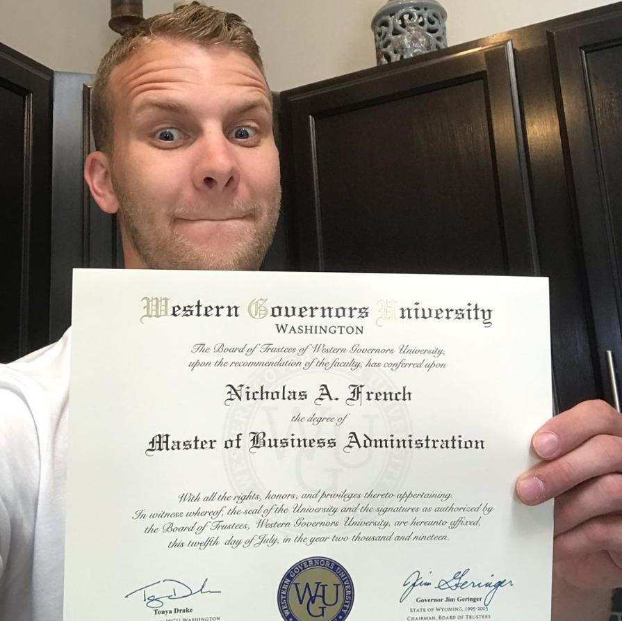 Image of me holding my WGU MBA diploma.