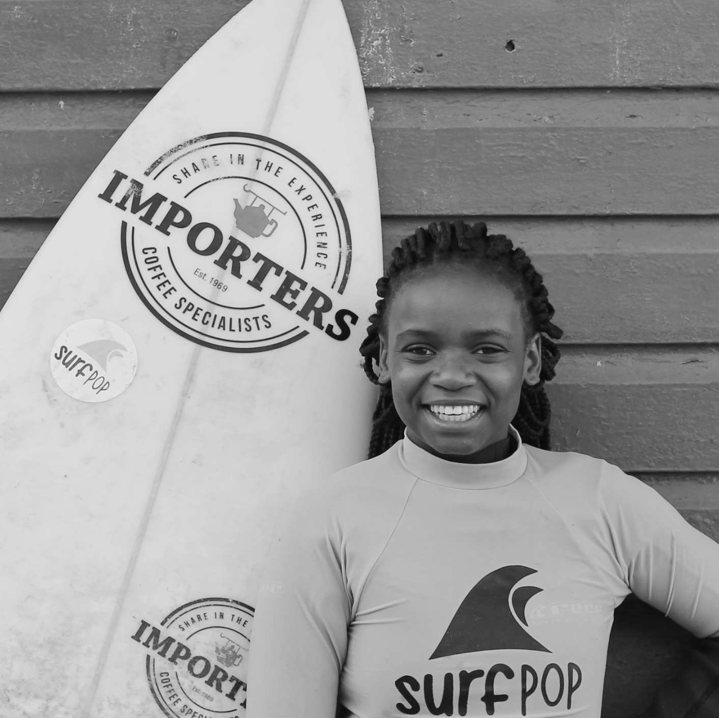"""I love surfing because it is challenging and it helps me focus on my studies. I enjoy being in the ocean because I forget all the problems. Surfing makes me feel strong and confident. Surfing is like a pill when I am sick. """