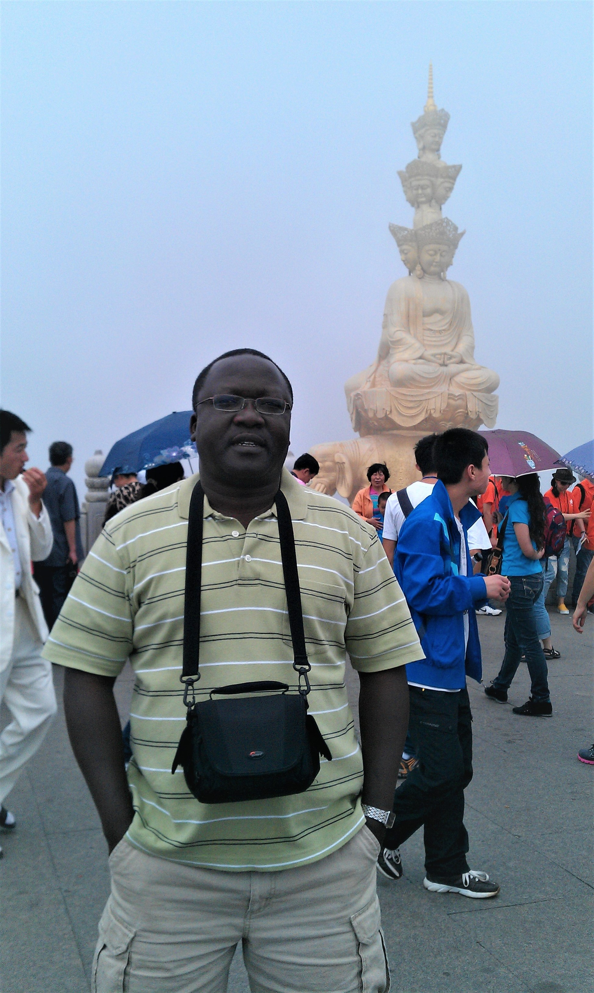 August 2011 in China. This is me at Mt. Emei, Golden Summit, a Buddhist attraction, in Sichuan Province.