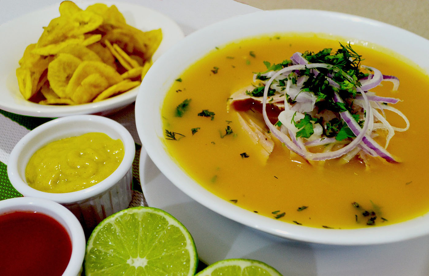 Encebollado - This dish consists of hot soup made with albacore, cassava, onion, and cilantro. It is usually served with fried plantains and sometimes served with rice and bread.This dish originated in the city of Guayaquil as a cheaper alternative to the ceviche. The dish grew popular the 1970s, especially after being a famous remedy for hangovers.This is one of the most traditional dishes in Ecuador, and you can find it all around Ecuador in huecas, markets, and restaurants.