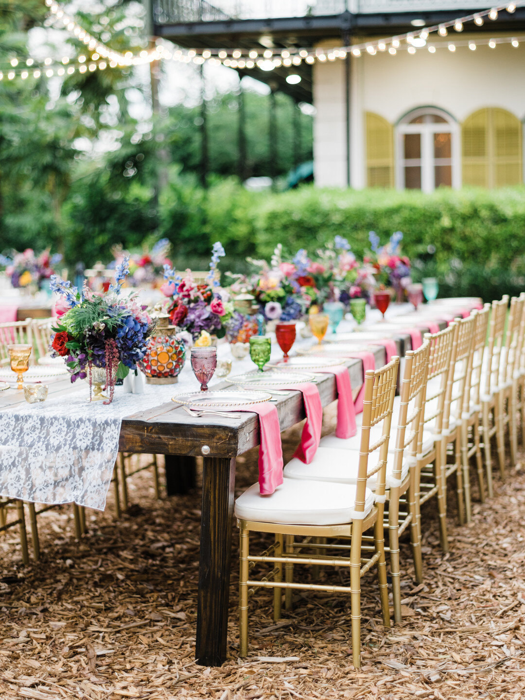 reception table covered with flowers and decor
