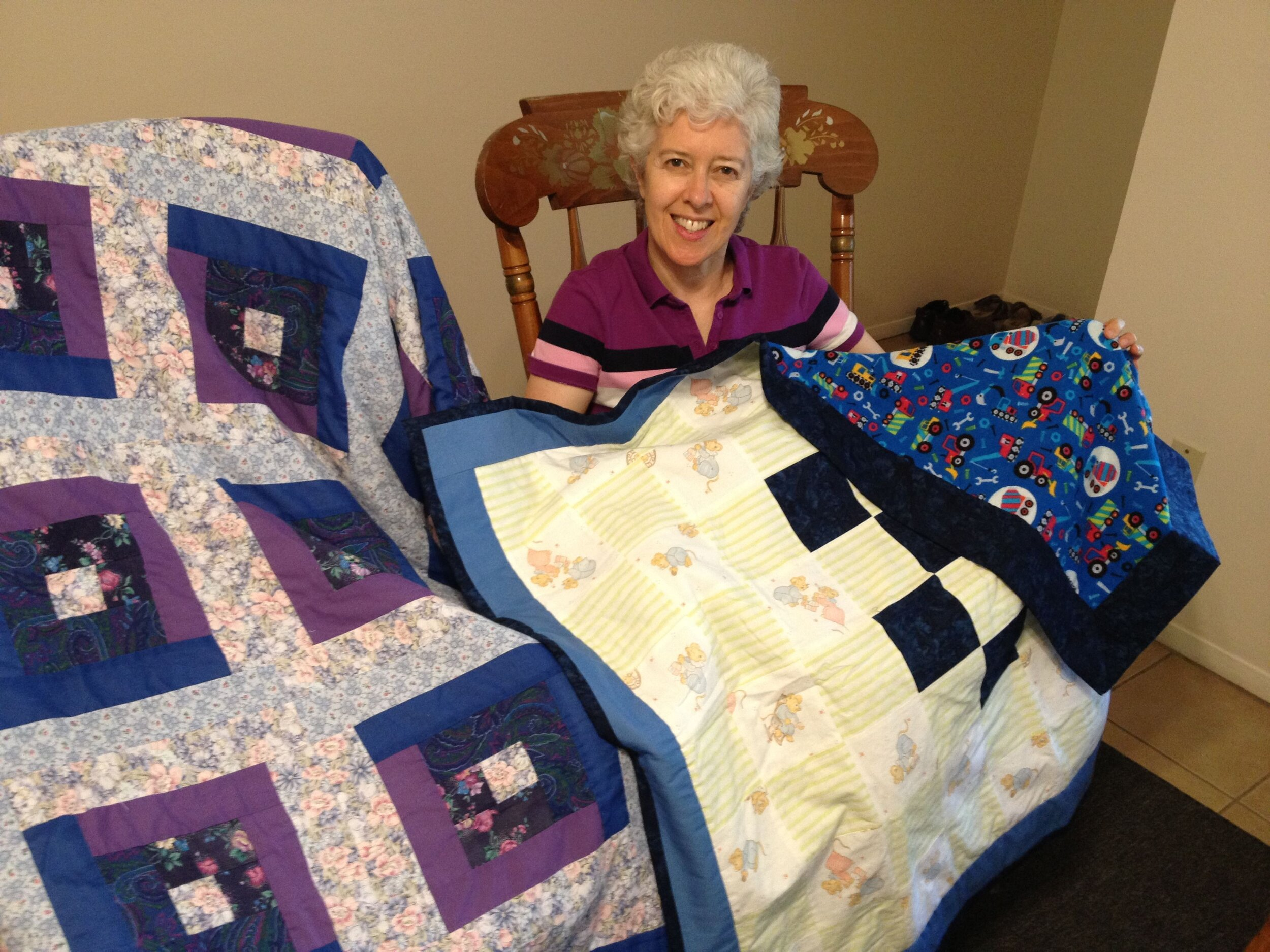 08-Cherie-with-baby-quilts-she-made-compressor.jpg