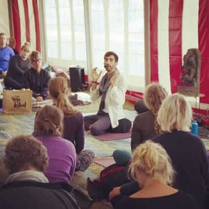 Cédric teaching a full class at Tisvilde Yoga festival