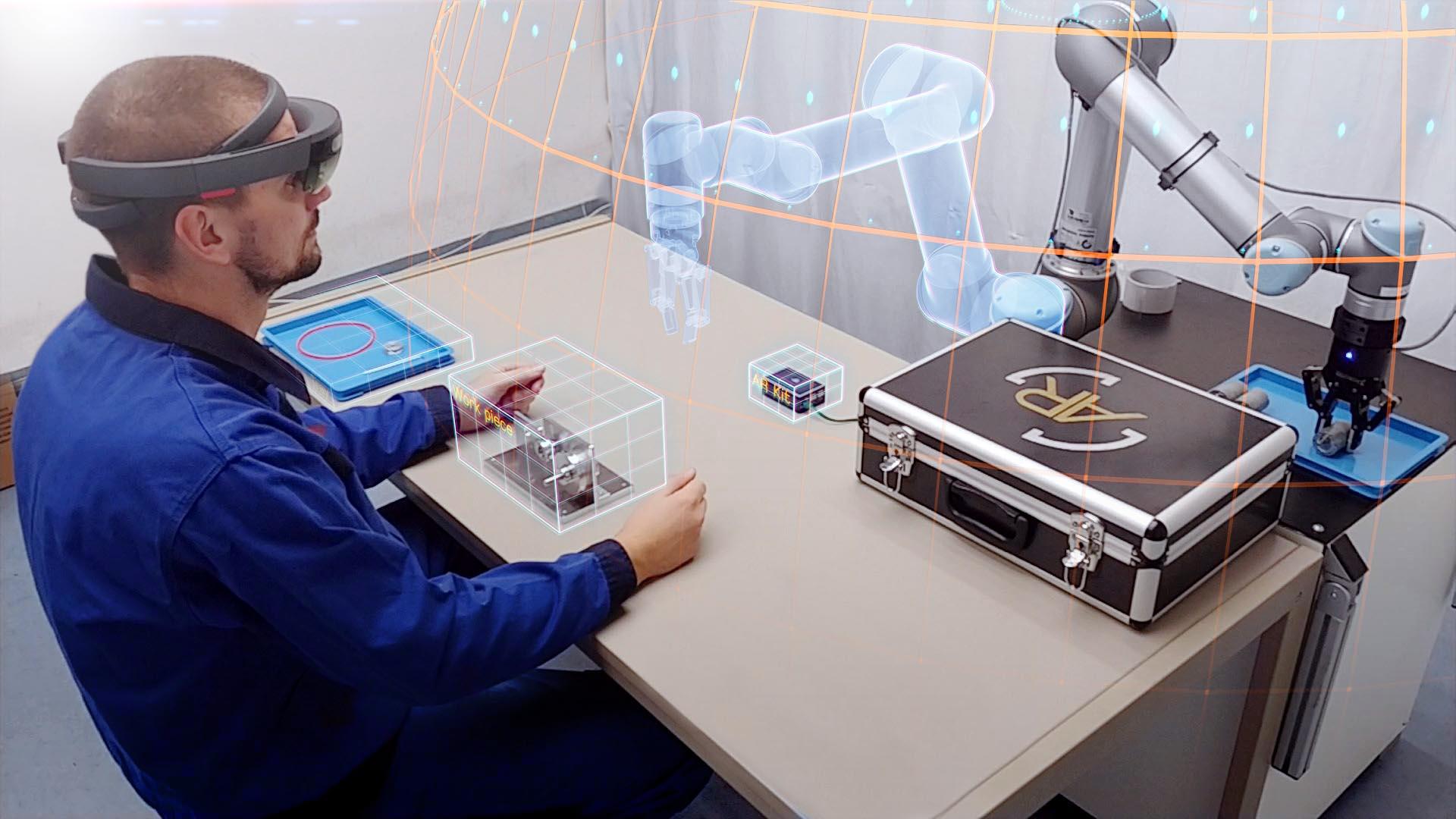 """Hybrides Arbeitssystem """"Augmented Robots"""", ermöglicht nahtlose Kollaboration durch Augmented Reality und intuitiver Gestensteuerung:  YouTube-Link"""