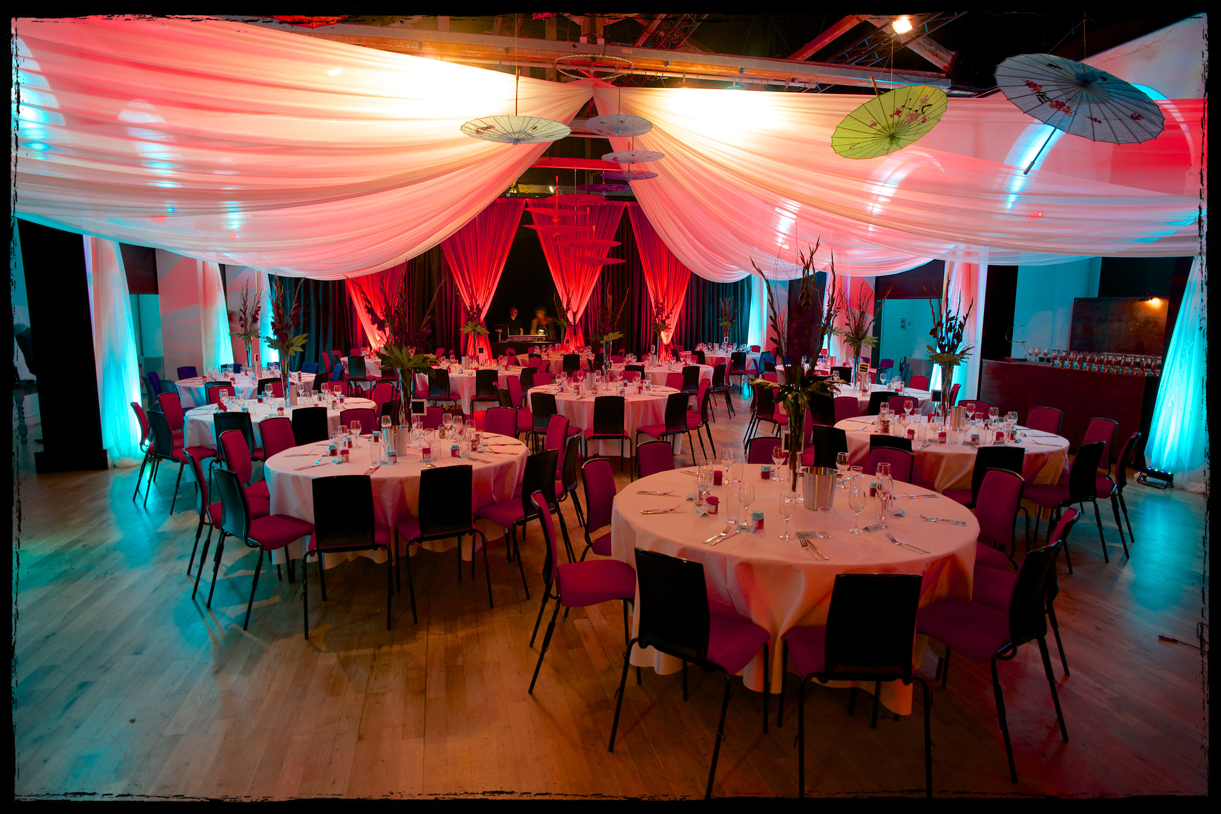 The main auditorium set up with cabaret tables for a party.
