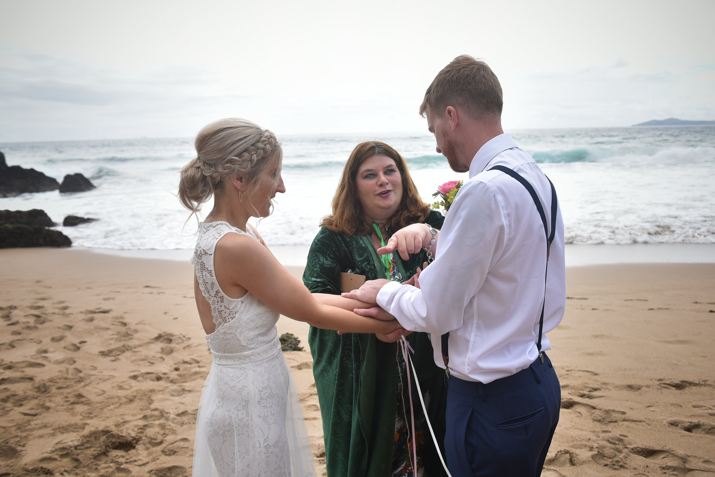 fasting hands wedding ceremony on beach ireland.jpg