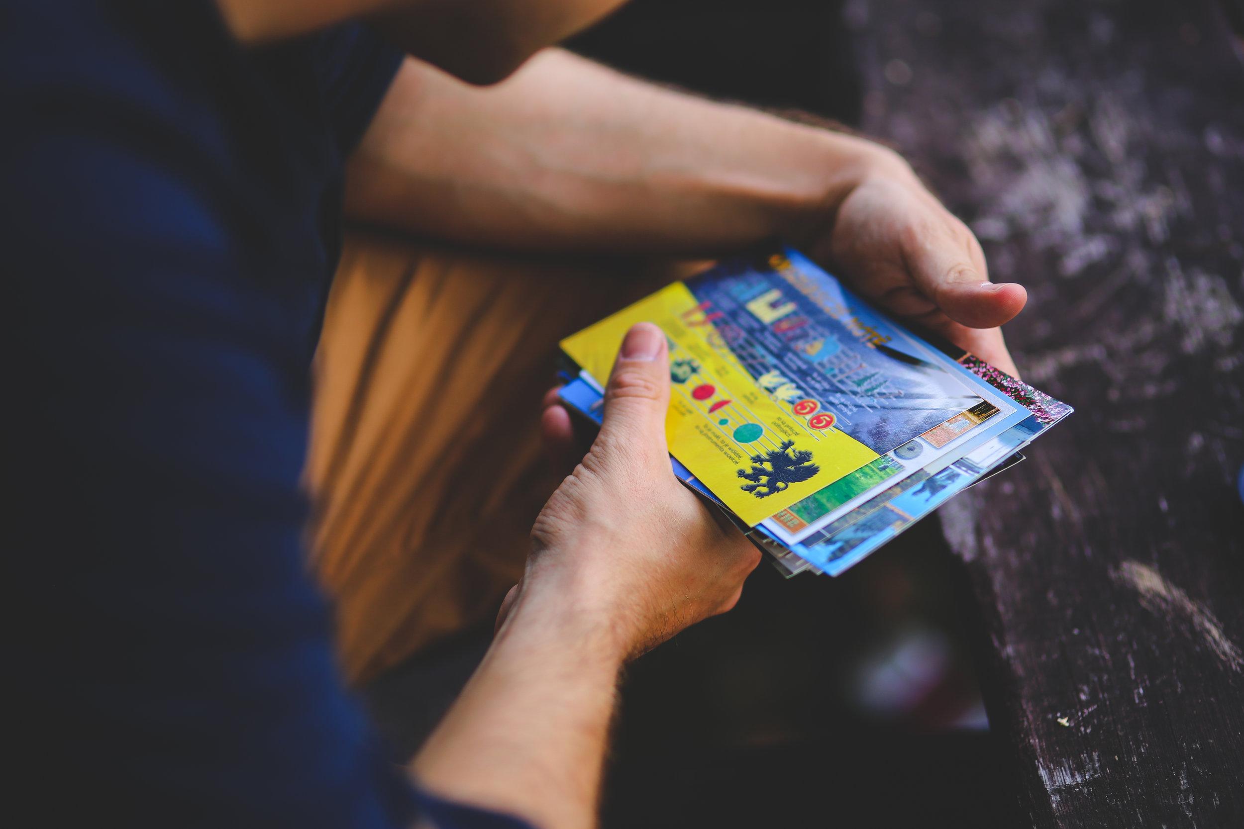 Canva - Man looking at postcards.jpg
