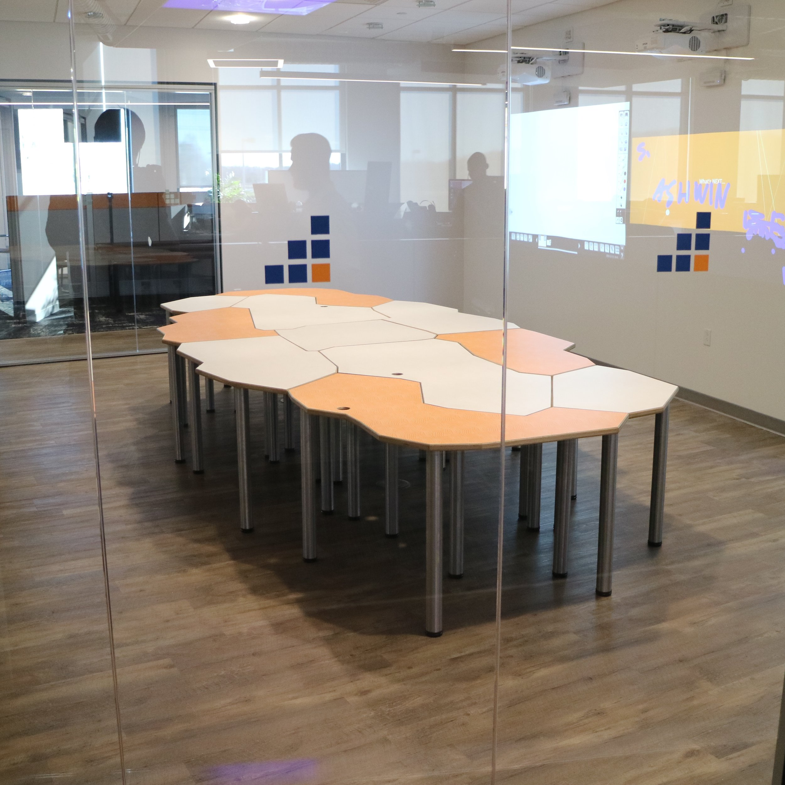 Tesselation Table — 44 legs, 11 reconfigurable tables for individual or small group use or as one large conference table