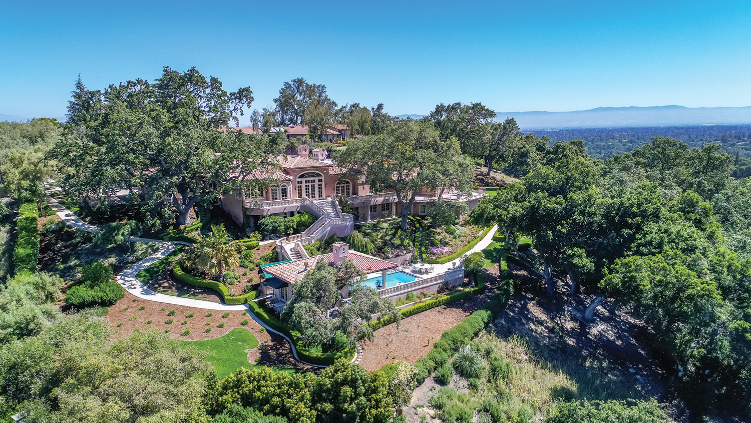 24020 Oak Knoll Circle,  listed with The Campi Group for $10,877,000